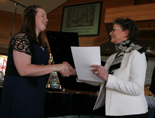 Marion Roubos-Bennett presenting singer Jessica Hughes with the PerfEx Non-Classical Award